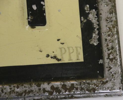 Prägemarke PPF bei Nummernschild CH 1